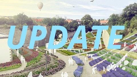 Parlanlage mit vielen bunten Pflanzungen und Schriftzug Update