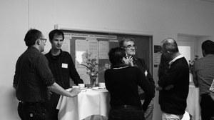 Die Abbildung zeigt das Foto einer Diskussionsrunde während der Planergespräche 2013.