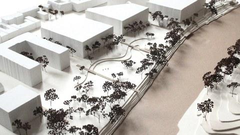 Foto eines Modells mit Häusern und Bäumen