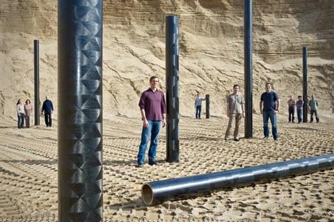 Mitarbeiter mit Formholzrohren