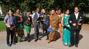 A group of festively dressed participants at the award ceremony