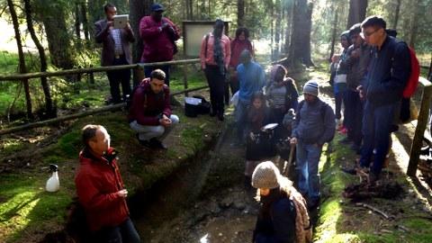 Course participants discussing a soil profile