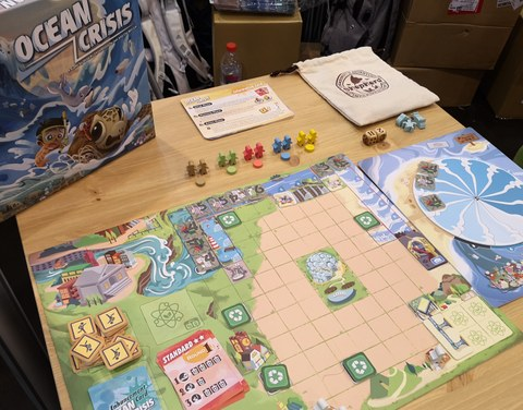 Game materials on a board game