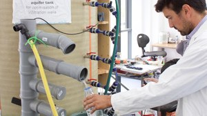 José takes measurements at the lab-aquifer tank