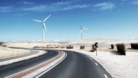 Windmills near a coastal road