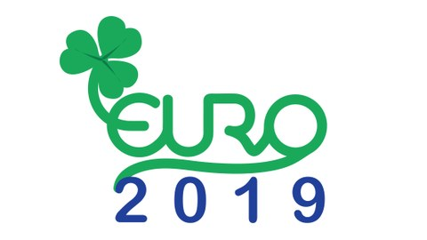 """Logo EURO 2019: green cloverleaf with green """"EURO"""" lettering and below a blue lettering """"2019""""."""
