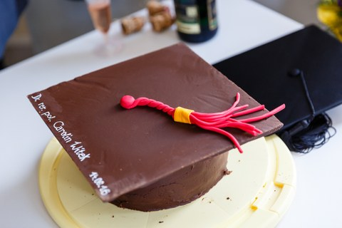 Cake in the shape of a doctoral cap.
