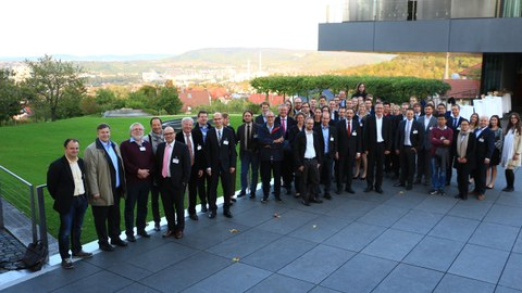Group picture of the participants outside in front of a building.