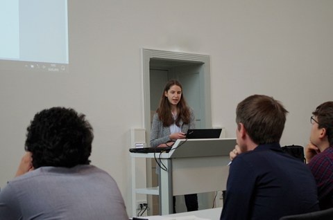 A member of the chair gives a lecture in front of several people.