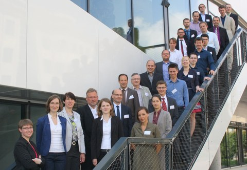 Participants of the doctoral workshop. 26 people stand on a staircase.