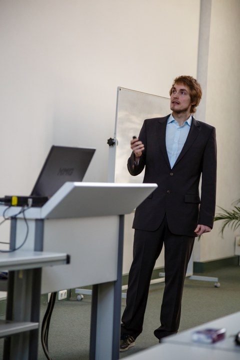 A man in a suit is giving a presentation.