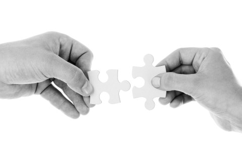Cooperation/people holding puzzle pieces