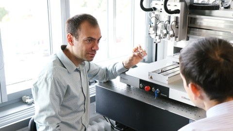 Ivan Minev in front of 3D Printer