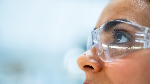 Female scientist with eye protection glasses