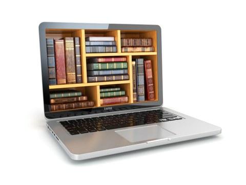 Laptop gefüllt mit Büchern