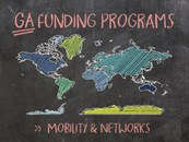 """Blackboard with heading """"GA funding programs"""" and """"Mobility & networks"""". Also shown is a sketch of a world map."""