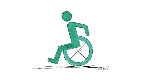 Ein Mensch fährt Rollstuhl.