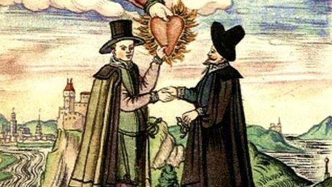 Bild zweier Männer, die sich mit Handschlag begrüßen und einer dabei das Flammende Herz Gottet im Himmel ergreift