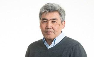Portrait photo of Dr. Ulan Kasymov.