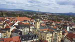 Picture with view of the city Zittau from a church tower. In the center of the picture you can see the Zittau town hall.