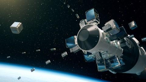 Künstlerische Darstellung der Oberstufe der Rakete Falcon-9 während des Auswurfs der Satelliten