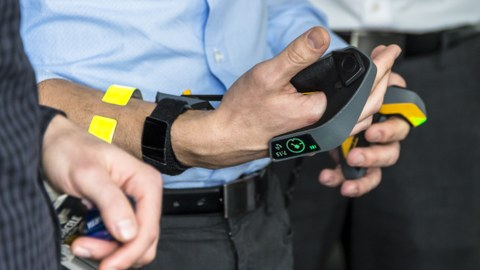 a Person is holding a newly invented remote system for controlling construction machines