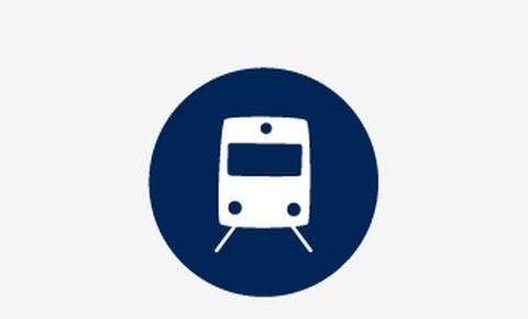 Grafik: ein weißes Symbolbild mit einem Zug von vorn auf blauem runden Hintergrund