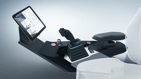 Seitenansicht einer Steuerkonsole für Baumaschinen, von links nach rechts sieht man ein Display, einen roten und schwarzen Knopf, einen Joystick mit Steuerkreuz, einen Mode-Schalter sowie Start-/Stop-Knopf und eine Armstütze. Im rechten Bildvordergrund ist ein Fahrersitz in transparentem Weiß angedeutet.
