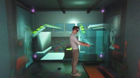 Auf dem Foto sieht man einen Mann mit VR-Brille, der in einer virtuellen Umgebung steht.
