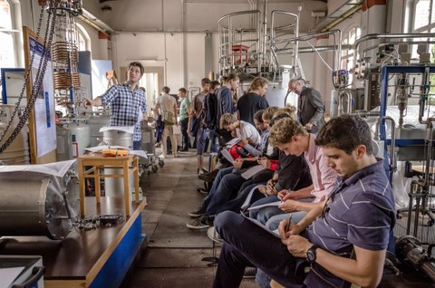 Participants of a Summerschool during a tour of a test facility.