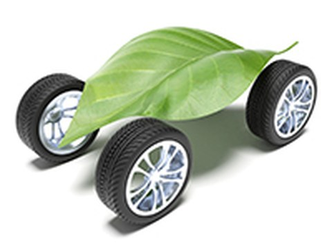 Four wheels connected by a big green leaf.