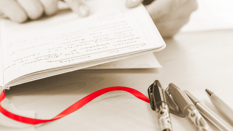 open note book with red bookmark