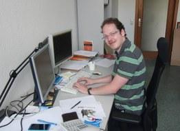 Andreas Naumann am Arbeitsplatz