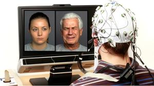 Ein Proband sitzt mit einer EEG Kappe und guckt auf das Bildschirm, wo zwei Gesichter präsentiert sind