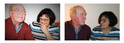 An older couple (a man and a woman) are laughing