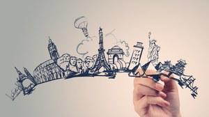 Eine Hand zeichnet in Form einer Silhouette, stilisierte Wahrzeichen verschiedener Hauptstädte.