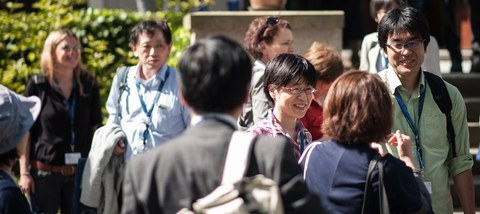 Japanese and German scientists in a sunny exchange outdoors