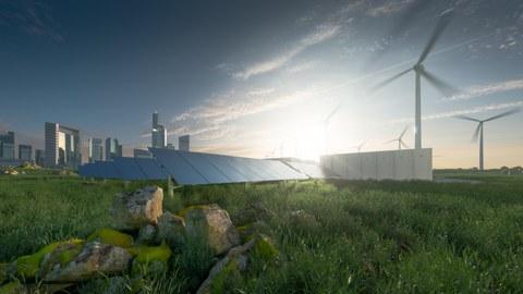 Bild von Windkraftwerk und Solarzellen im grünen vor einer Stadt aus Glas