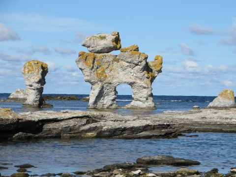 Limestone colums standing in shallow sea water