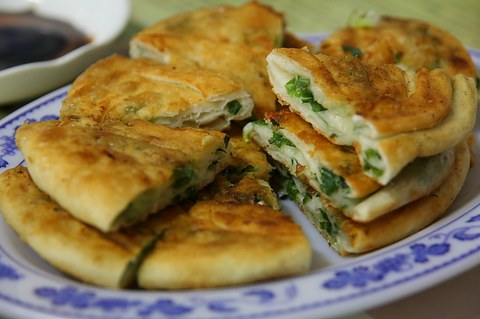 A plate of green onion pancakes