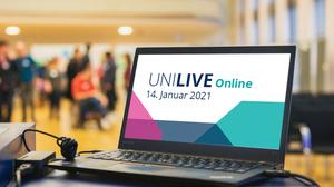 Foto mit aufgeklappten Laptop im Vordergrund. Auf dem Laptop ist ein Graphik von UNI LIVE 2021. Mit Textzeilen UNI LIVE 2021 14. Janauar 2021