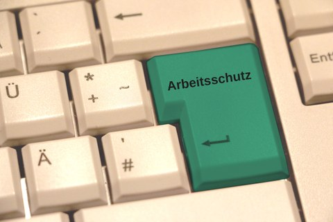 "Keyboard with the inscription ""Arbeitsschutz"" on the ENTER key"