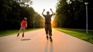Two persons inline skating