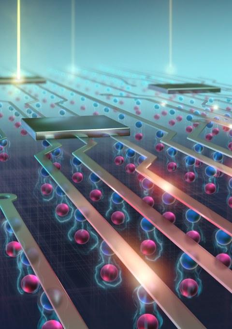 Vergrößertes Schema eines elektronischen Chips, man sieht auftreffendes Licht und unter den Leitbahnen rosa und blaue Kugeln übereinander.