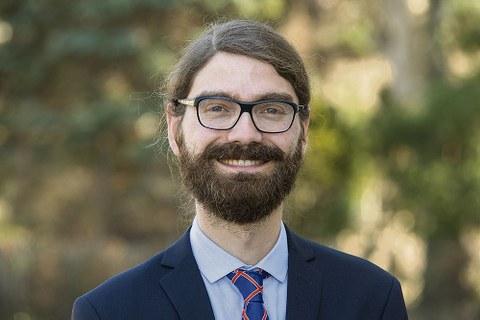 Porträt von Juniorprofessor Dr. Mario Baumann.