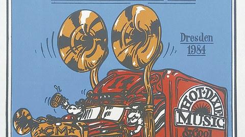 """Auf dem Plakat des 14. Dixieland-Festivals ist ein gezeichneter, roter LKW mit der Aufschrift """"Hot Dixie Music"""" zu sehen. Die beiden überdimensionierten Lautsprecher an der Fahrerkabine sowie die Fahrerkabine selbst sind im Goldton gehalten."""