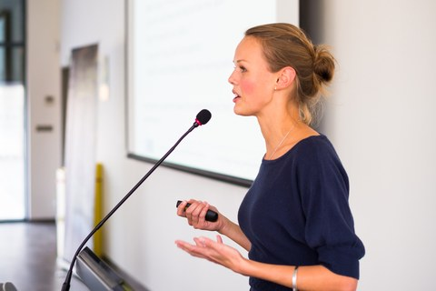 Young scientist speaking to an audience