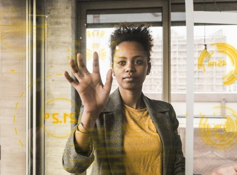 young woman working with touchscreen