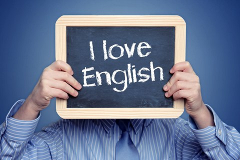 "Man with signboard in front of his face saying ""I love English"""