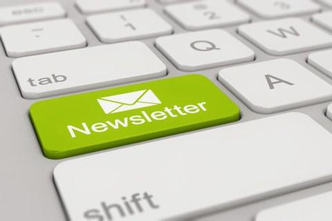 Tastatur mit grüner Newsletter-Taste